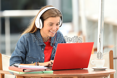 happy student listening a video tutorial