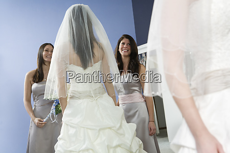reflection of a bride with bridesmaids