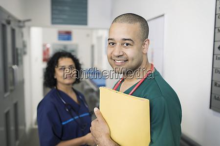 portrait confident doctors in hospital corridor