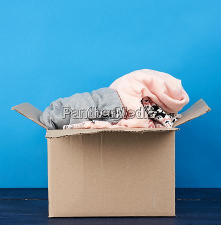 brown cardboard box full of various