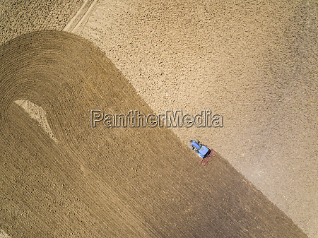 aerial view of tractor in farm