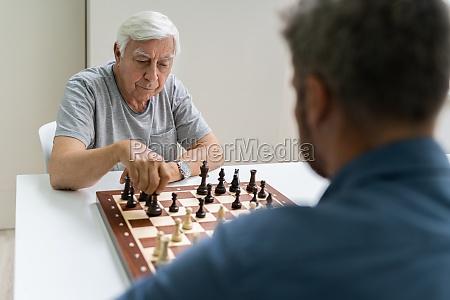 elderly senior playing chess