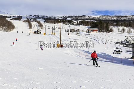 bjorli village skiers piste and chair
