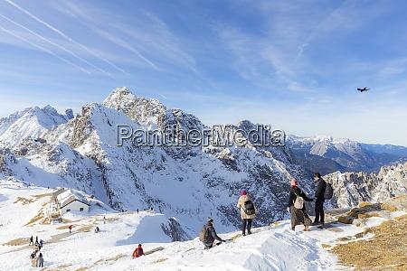 tourists descends from hafelekar peak the