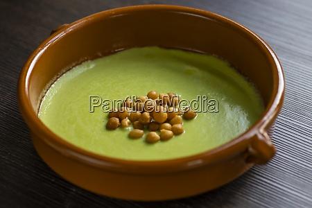 still life of green peas soup