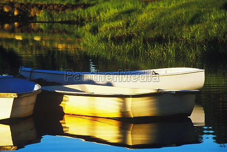 reflection of boats in a lake
