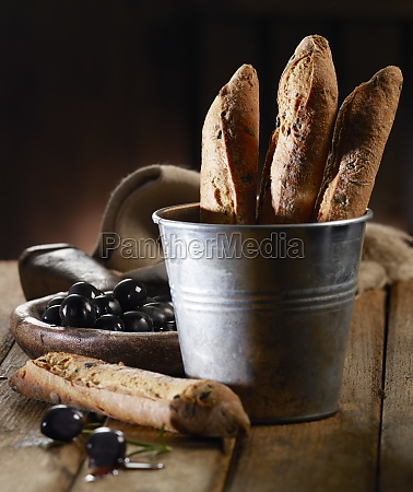 olive baguettes in a metal bucket